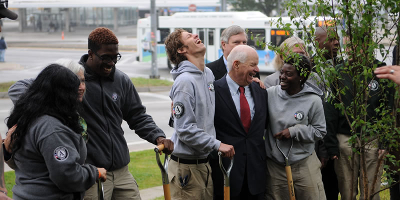 Volunteers with Americorps plant trees with Senator Ben Cardin and others in west Baltimore.