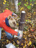 [photo:] Collecting a precipitation sample located under a deciduous canopy in Boundary Waters Canoe Wilderness Area of the Superior National Forest.