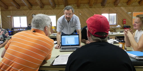 [photo:] Land managers learning to use computer tools.