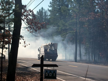 [photo:] Smoke from a low-intensity prescribed fire in the New Jersey Pine Barrens affecting traffic on a highway adjacent to the prescribed fire burn unit. Photo by Warren Heilman, US Forest Service.