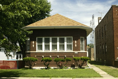 Chicago area house shaded by large tree.  Photo by Keith Weller.