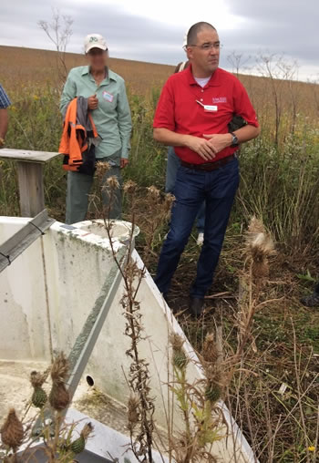 Matt Helmers from Iowa State University discusses STRIPS near a flume. Photo by Jane Hodgins, US Forest Service.