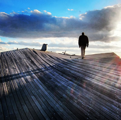 [photo:] Klaas Armster assesses the Rockaway boardwalk after Hurricane Sandy, November 2012