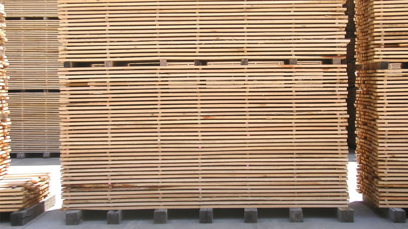 Cut and dried lumber is stacked and awaiting transportation to a manufacturing facility.